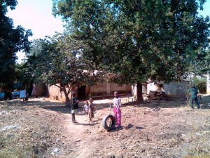 """Boy with car tyre """"Bike"""" - Chamboli_kitweonline"""