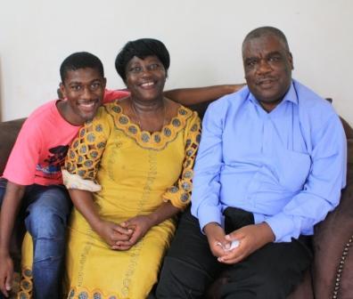 Alfayo with his parents